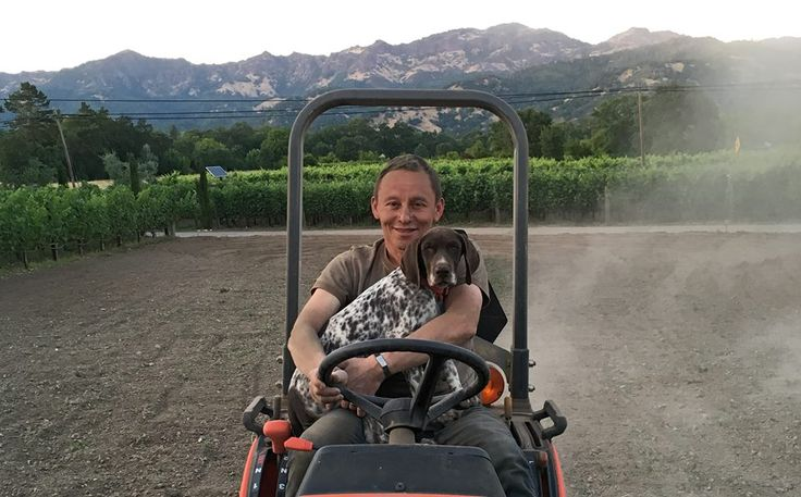 Elias Fernandez (winemaker) and his buddy Milo taking a spin on a tractor!