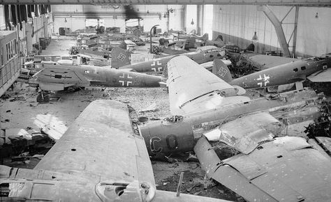 File:A hangar full of wrecked German aircraft at Schmarbeck airfield, Germany, 20 April 1945. In the foreground are Heinkel He 111 and He 177 bombers. BU4123.jpg