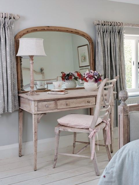 This coastal bedroom with Silver Mist Moonflower curtains is timeless. Our small desk can be used also as a relaxed yet efficient dressing table. Lamp in plain framed linen with a standard whitewashed lampbase