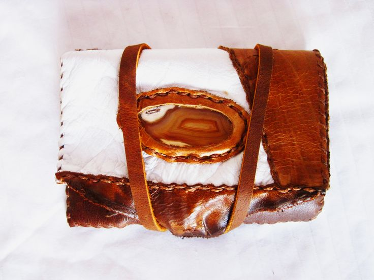 "Brown/white sliced agate with white&brown leather wallet.  ""The stone was given its name by Theophrastus, a Greek philosopher and naturalist, who discovered the stone along the shore line of the river while searching for algy Achates sometime between the 4th and 3rd centuries BC."""