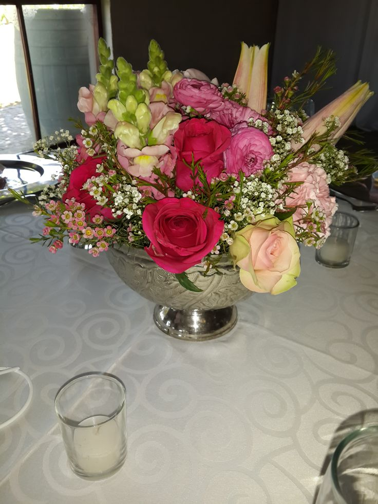 Shades of pink center piece in silver bowl with stargazer