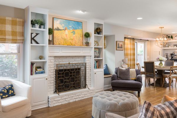 White Painted Fireplace Yellow And Blue Decor Gold Light Fixture Living Room Update White Brick Fireplace White Painted Fireplace