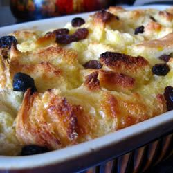 Favourite Bread Pudding II - Allrecipes.com:  6 slices day-old bread    2 tablespoons butter, melted    1/2 cup raisins (optional)    4 eggs, beaten    2 cups milk    3/4 cup white sugar    1 teaspoon ground cinnamon    1 teaspoon vanilla extract