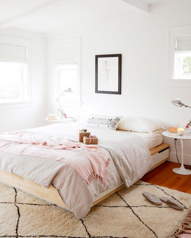 Feminine bedroom with large morrocean rug, and soft blush-and-gray styling