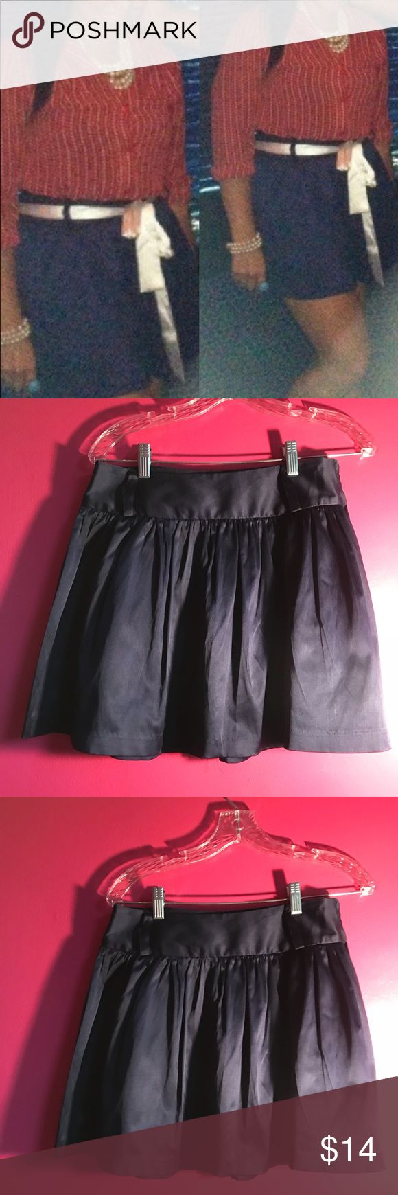 Forever 21 dark navy satin mini skirt szM Hey all! I am selling this cute mini skirt from forever 21. The skirt is a dark navy color as seen in the picture. It also has belt straps so it is great to pair with any color belt. Please note I am not including any belt with this skirt.   Length: 15 Width: 16  Let me know if you have questions! Forever 21 Skirts Mini