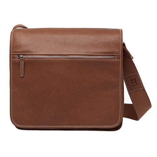 A Finnish favorite swaps its cotton canvas interior for some genuine leather in copper brown. Marimekko Olkalaukku Brown Leather Messenger Bag - $325