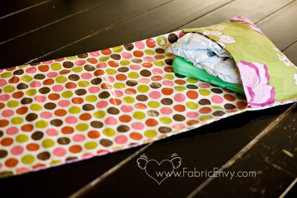 Fabric Envy: All in One Diaper Clutch and Changing Pad by Cluck Cluck Sew. I need two of these. One for my purse and one for the car.