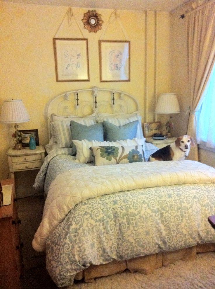 BM Cream Yellow/ Suntan walls. Powder blue & white bedding