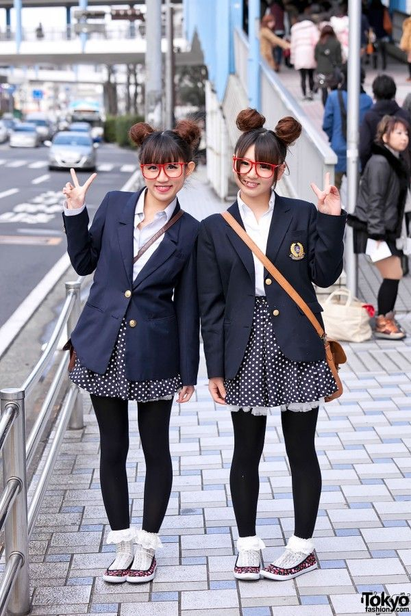 """pair style"" with twin buns, matching school blazers, polka dot skirts and red glasses"