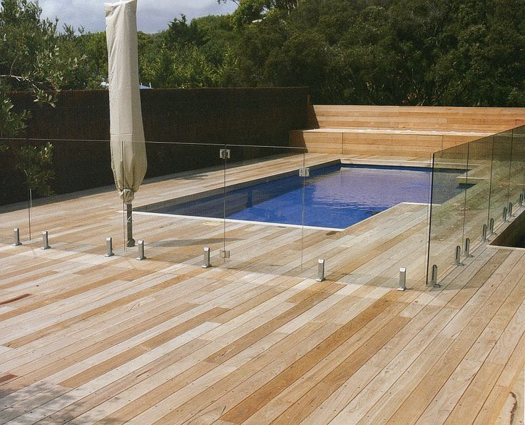 Outdoor Swimming Pool Design Idea With Wooden Deck And