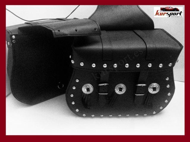 Alforjas cuero PU 3mm semi-rigidas 20 litros motos Kawasaki Honda Suzuki Yamaha RI-015-SB Medidas y descripcion: precio x 2 unidades - Largo: 38m - Ancho (grosor): 14cm - Altura: 29,5cm - 20 litros de capacidad por cada alforja. - Alforjas de moto custom con tachas, Conchos y flecos. - Fabricadas en cuero sintetico con 3mm de espesor. - 2 Aletas interiores superpuestas con broche para una mayor seguridad de su