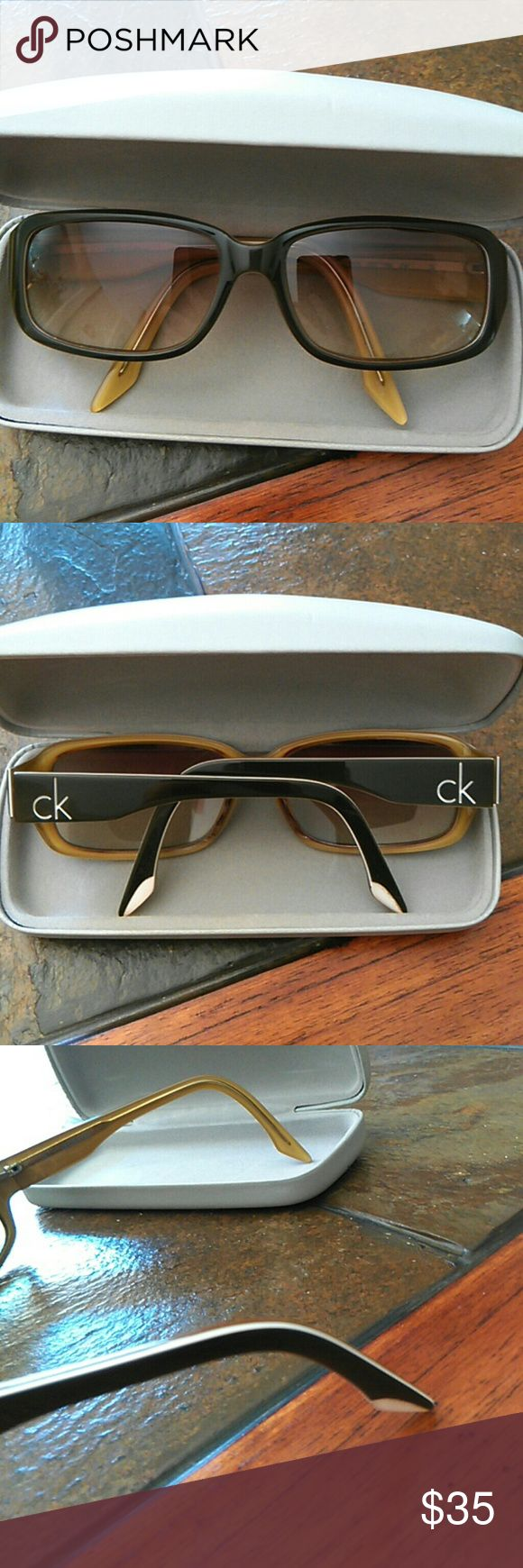 Calvin Klein tinted prescp. sun glasses CK 4011S  113  57/16  135.  Lenses can be removed to have new prescription lenses put in.  They are like an olive color on the inside. Calvin Klein Accessories Glasses