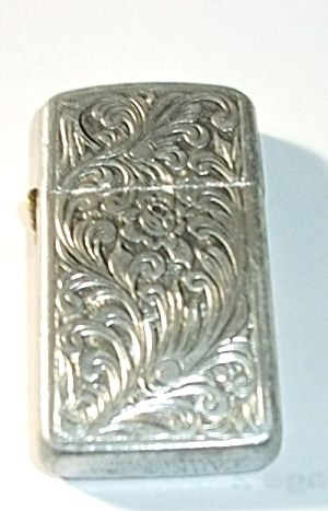 1970`S LADIES SLIM PARK FLORAL ALUMINUM LIGHTER. Click on the image for more information ...