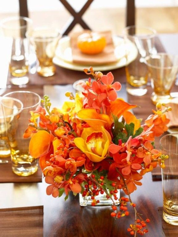 Beautiful flowers brighten up this table.  Bali tip:  Keep your floral arrangements low so that you don't obstruct your view across the table.