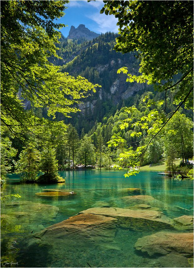 Romantic Forest Lake Blausee Is One Of The Best Known Mountain Lakes In Switzerland Thanks To