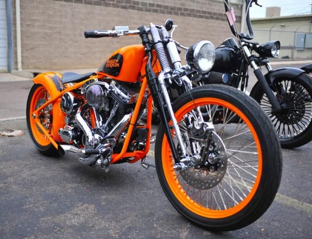 Bright orange Harley Davidson.    OEM Harley Replacement Batteries that are made in the USA--like your Harley.  www.throttlexbatteries.com