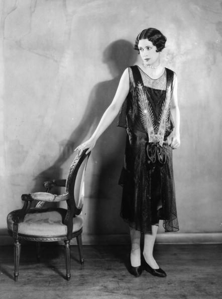 1927    A model wearing an evening dress typical of the period. (Photo by Sasha/Getty Images)