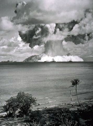 In July 1946, the US military carried out Operation Crossroads over Bikini Lagoon in the Marshall Islands. The purpose of the test was to study the effects of nuclear radiation on large ships. 90 vessels were used for the test. Several of these ships can be seen silhouetted against the blast.
