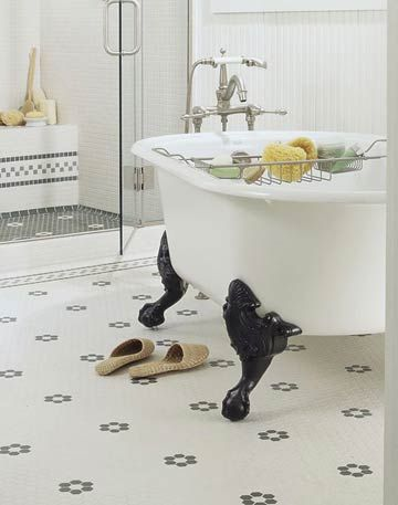 This bathroom gets its vintage flair from its mosaic-tile flooring and claw-foot tub. More bathroom flooring ideas: http://www.bhg.com/bathroom/flooring/bathroom-flooring-ideas/?socsrc=bhgpin061513clawfoottub=7