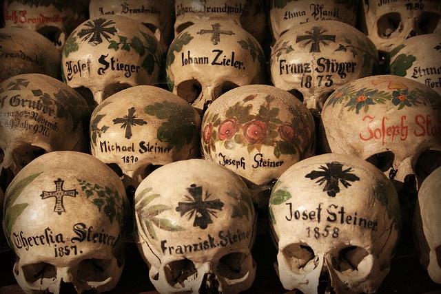 Elaborately painted skulls neatly stacked in a church in Hallstatt