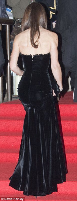 Duchess of Cambridge in a strapless black velvet McQueen gown to a military awards ceremony. This gown accentuated her enviable figure.