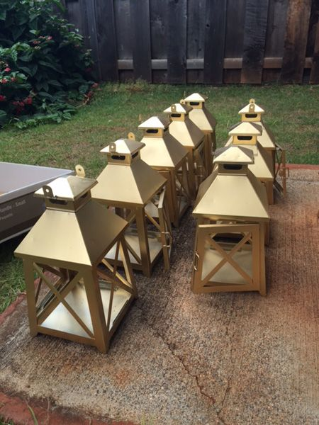All in all, I'd say these DIY gold lantern centerpieces were a win for the Eel wedding budget! And they go perfectly with our color scheme.