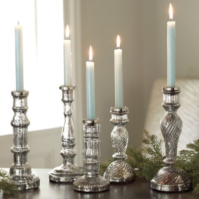 Antiqued Mercury Glass Candlesticks - Assorted Set of 5  In the early 19th century, most art glass was clear-blown or pressed. So, when mercury glass first appeared at a London exhibition, it took the continent by popular storm. Our Antiqued Mercury Glass Candlesticks recreate that vintage romance in flickering candlelight.