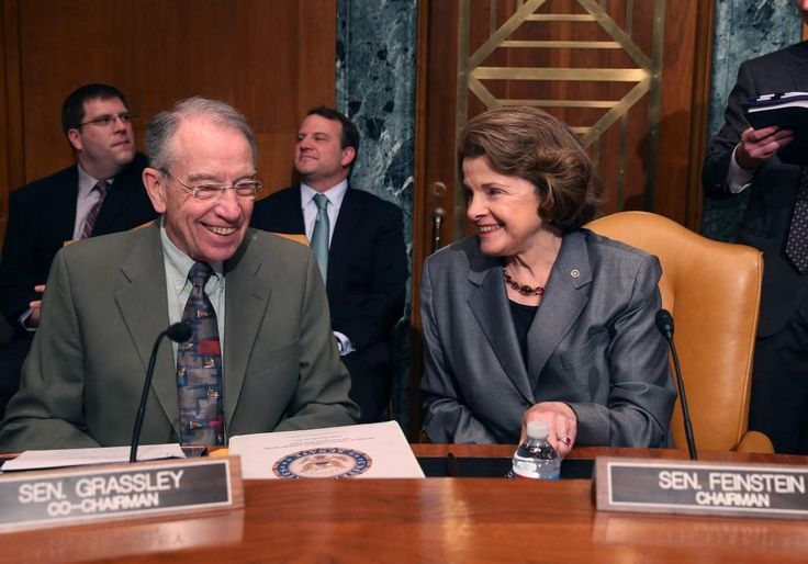 U.S. Sen. Dianne Feinstein (D-CA) (R) and U.S. Sen. Chuck Grassley (R-IA) talk during s Senate Caucus on International Narcotics Control hearing on Capitol Hill in Washington, DC, on May 14, 2014.