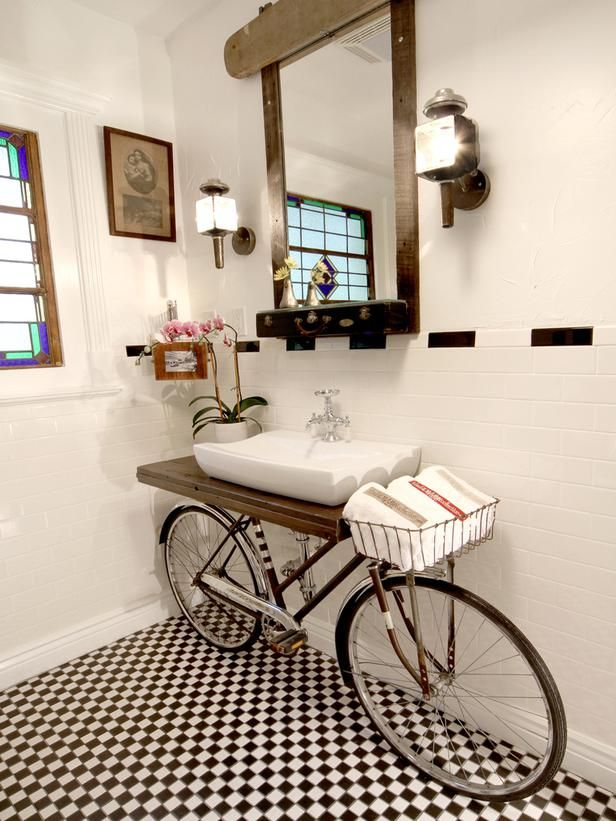"""20 Upcycled and One-of-a-Kind Bathroom Vanities: This vanity is a Pinterest phenomenon. """"It's the sink that made me famous,"""" says artist Benjamin Bullins. """"People ask me where the inspiration came from, but it was really more opportunity than inspiration."""" Bullins was designing a client's bathroom, and the client's mom's neighbor knew he worked with recycled materials, so she broug…"""