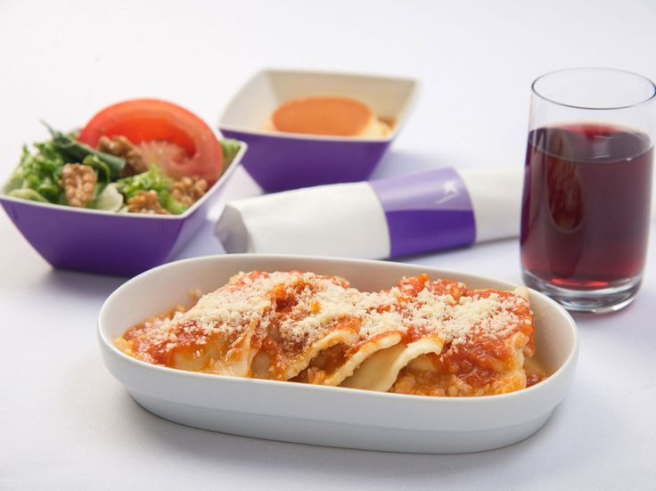 15 Economy Class Airline Meals You'll Actually Want to Eat LAN Airlines: Lasagna with Malbec and Flan This is one instance where you'll want to choose the pasta