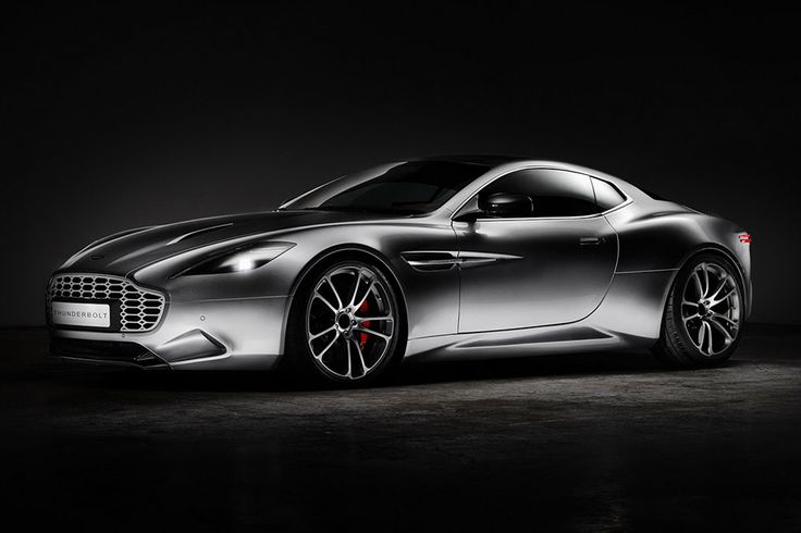 """Created as a pure design study, the Henrik Fisker Aston Martin Thunderbolt Vanquish isn't an """"official"""" Aston Martin. Not that it matters. This one-off touring coupe features hand-laid custom carbon fiber bodywork boasting Fisker's signature creaseless side panels and deep..."""