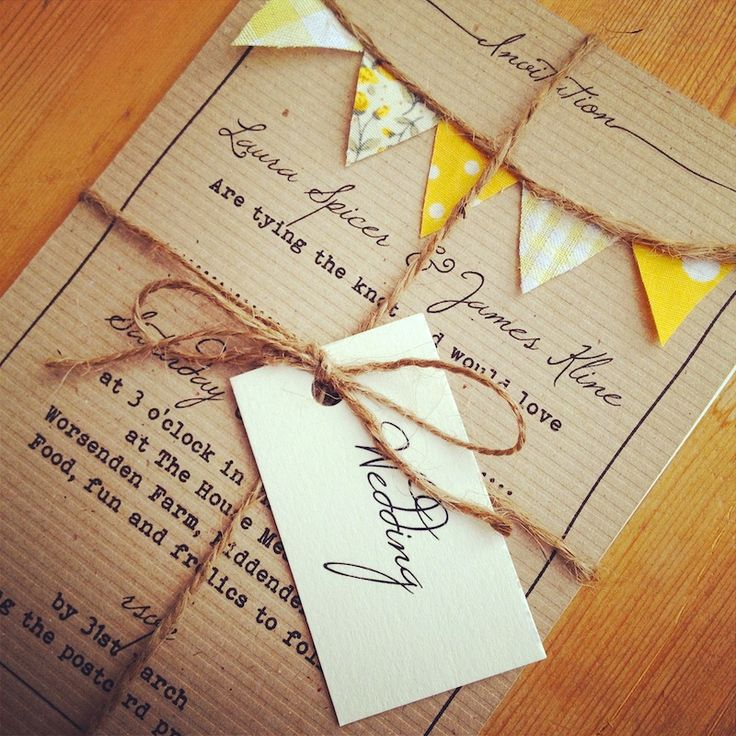 Beautiful handmade invites. Typewritten onto cardboard and finished with cut out bunting and twine.