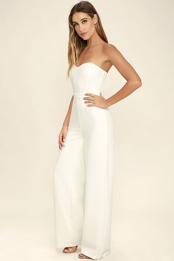 Let the Pop Life White Strapless Jumpsuit be your new dance partner! Medium-weight poly fabric constructs a seamed bodice with hidden boning and no-slip strips for a figure-enhancing fit. Wide-leg pants fall from a high, fitted waist with a removable belt. Hidden back zipper with clasp.