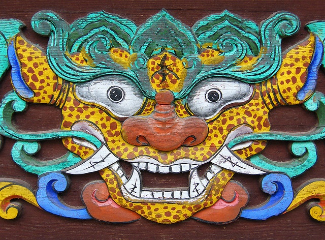 Smiling Dragon carved in Korean temple doors