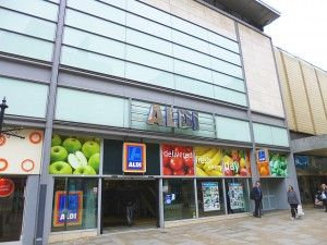 Supermarket Store Exteriors and Shop Fronts | High-street Aldi in Manchester's prime Market Street (1 Jul 2013)