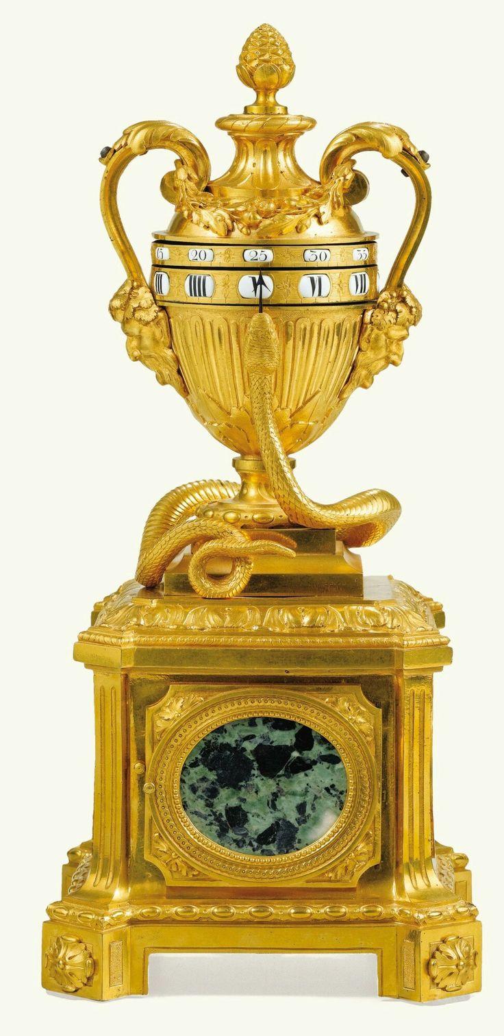 A LOUIS XVI GILT-BRONZE AND VERDE ANTICO MARBLE CLOCK, CIRCA 1775.