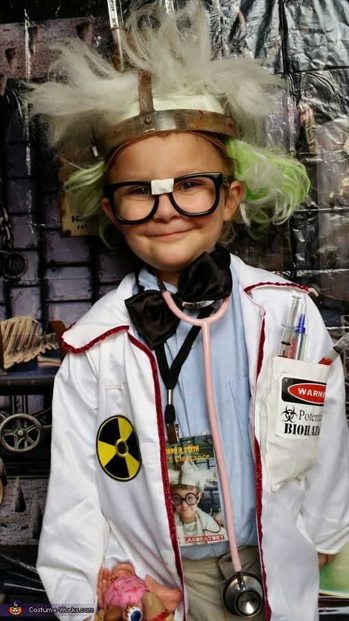 Libbie: I made this costume for my grand daughter Leah. I bought the light up wig on clearance last year. The lab coat was a toy coat that I glued pockets...