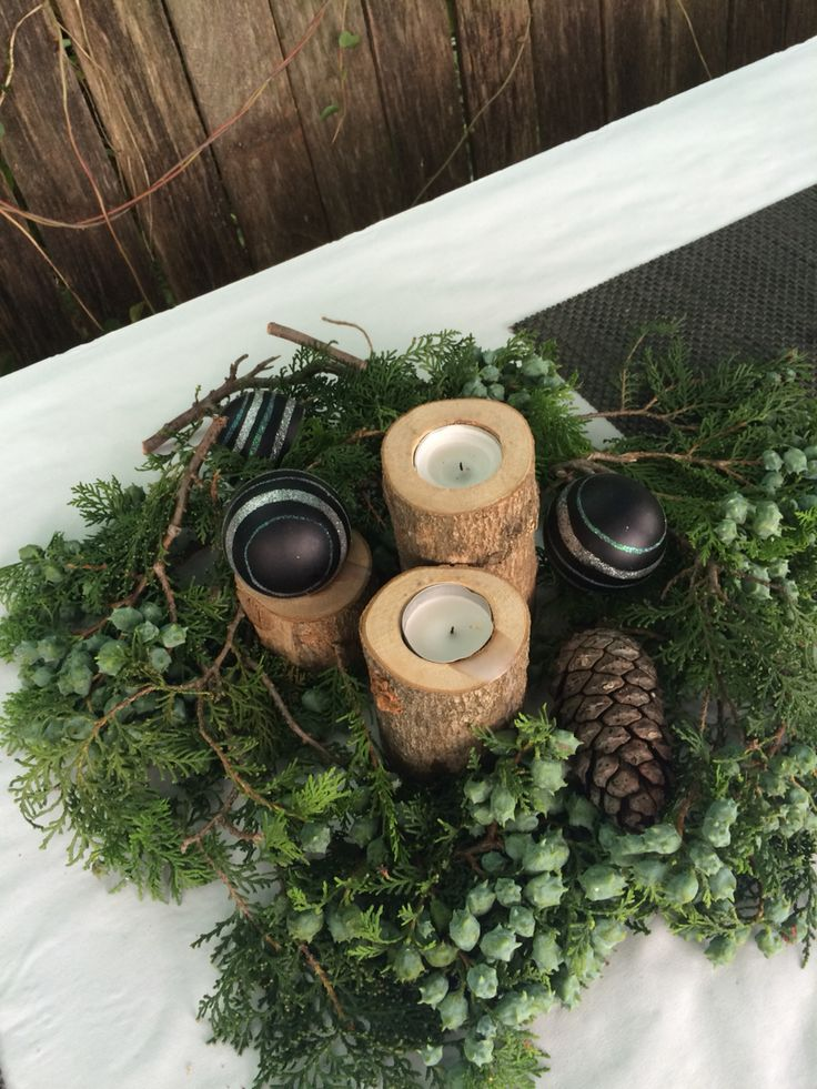 Wreath made of pine cones and candles