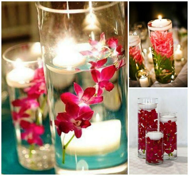 Velas con flores sumergidas, preciosas y elegante.
