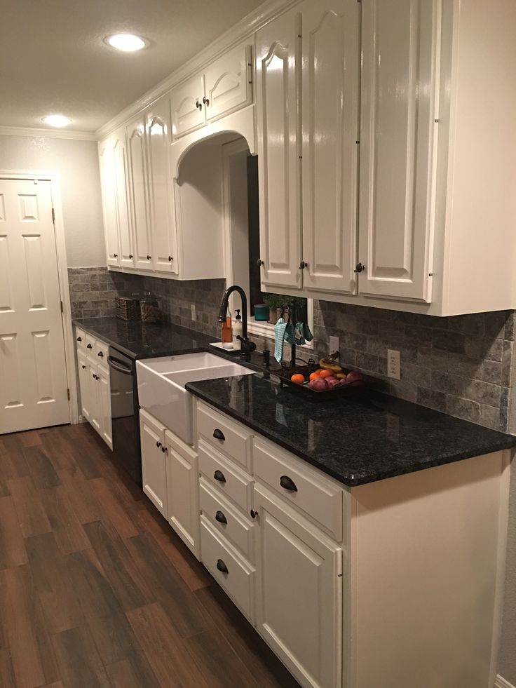 Black stainless steel appliances. Steel gray counter tops ...