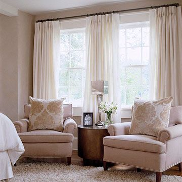"Traditional Home with Southern Charm, Calm and Collected:   Kristen Cox adopted a unique approach for the master bedroom windows. Rather than the standard two-panel treatment, she installed three drapery panels to create ""another layer of interest and a pretty breeziness,"" she says."