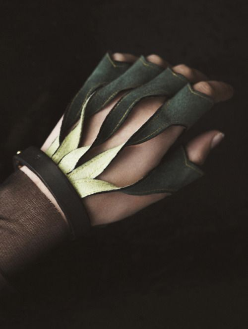 I think the dark background images really make the gloves stand out more and the details on them