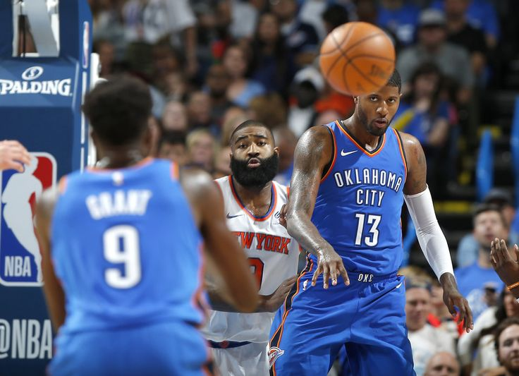 Oklahoma City's Paul George (13) passes the ball from beside New York's Kyle O'Quinn (9) during an NBA basketball game between the Oklahoma City Thunder and the New York Knicks at Chesapeake Energy Arena in Oklahoma City, Thursday, Oct. 19, 2017. Oklahoma City won 105-84. Photo by Bryan Terry, The Oklahoman
