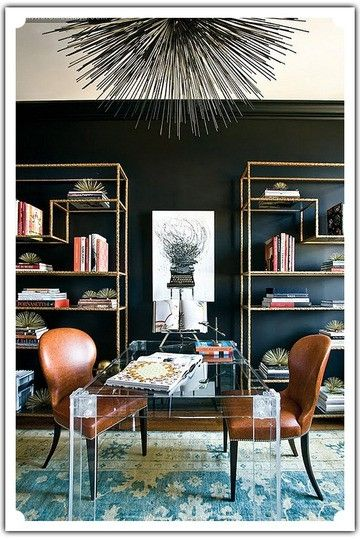 black wall, gold bookshelves --statement desk