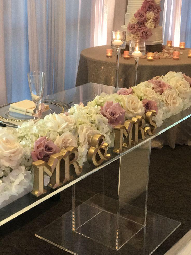 Custom made clear acrylic sweetheart table. Gold Mr. & Mrs