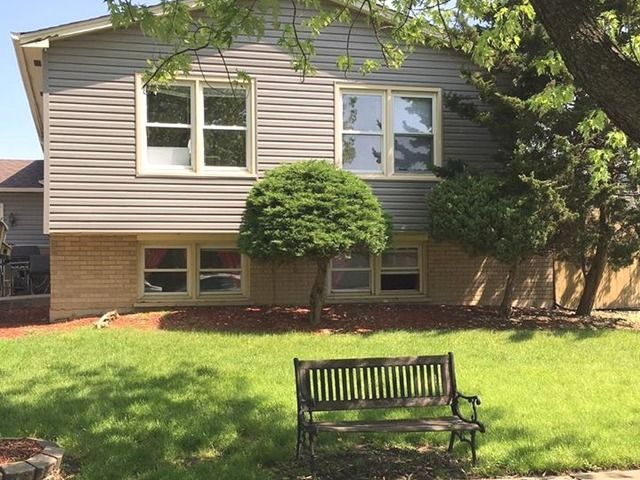 Come check out this wonderful split-level home. Needs some TLC.   Great neighborhood, good schools, close to schols, shopping and public transportation.