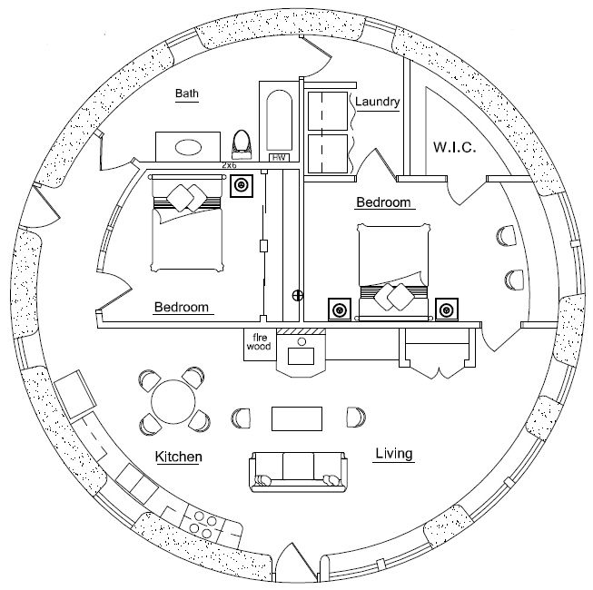 Straw bale round house with the wood stove in the center for Straw bale home plans