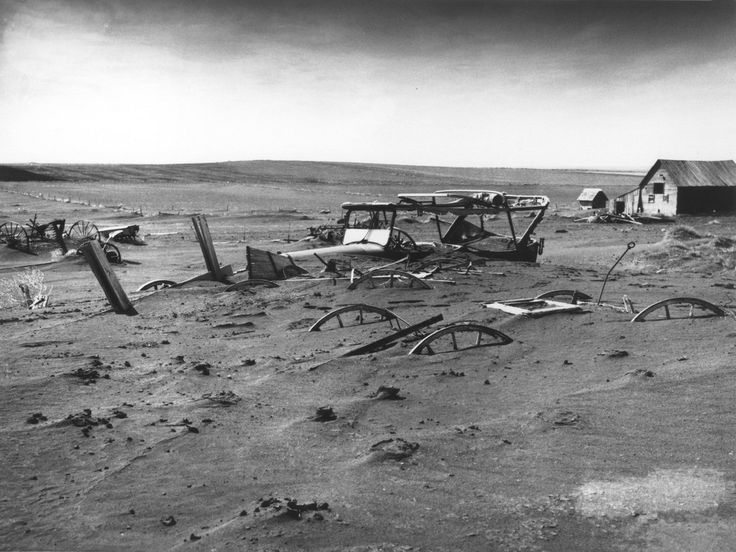 Buried machinery, due to Dust Bowl conditions, in a barn lot in Dallas, South Dakota on May 13, 1936.