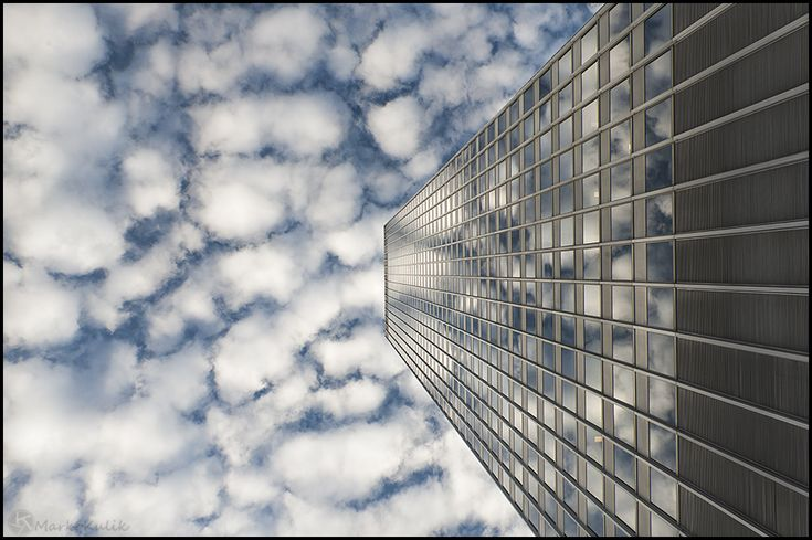 I'm a big fan of exploring different angles in my photography and in this image the fabulous sky was reflecting in the windows of Place Ville Marie in Montreal. It made perfect sense to me to lie down on my back and use the beautiful sky as a background. In this way our eye follows the building right up to the sky.