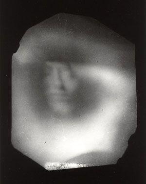 """Paolo Gioli, """"La finestra in pugno"""", 1989 stampa fotografica in bianco e nero da negativo  realizzato con il pugno, cm 18x13"""